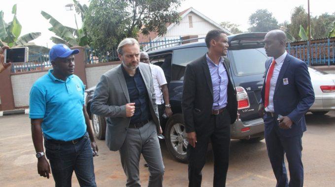 Desabre Sebastien (2nd Left) arriving at FUFA House accompanied by FUFA CEO, Edgar Watson & Spokesperson, Ahmed