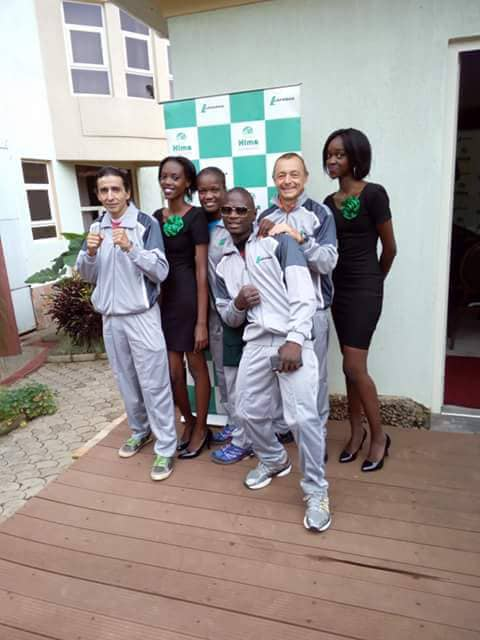 Shaky Mubiru together with his coach, Adam (L) and training partner, Patricia Apolot (3rd from Left)