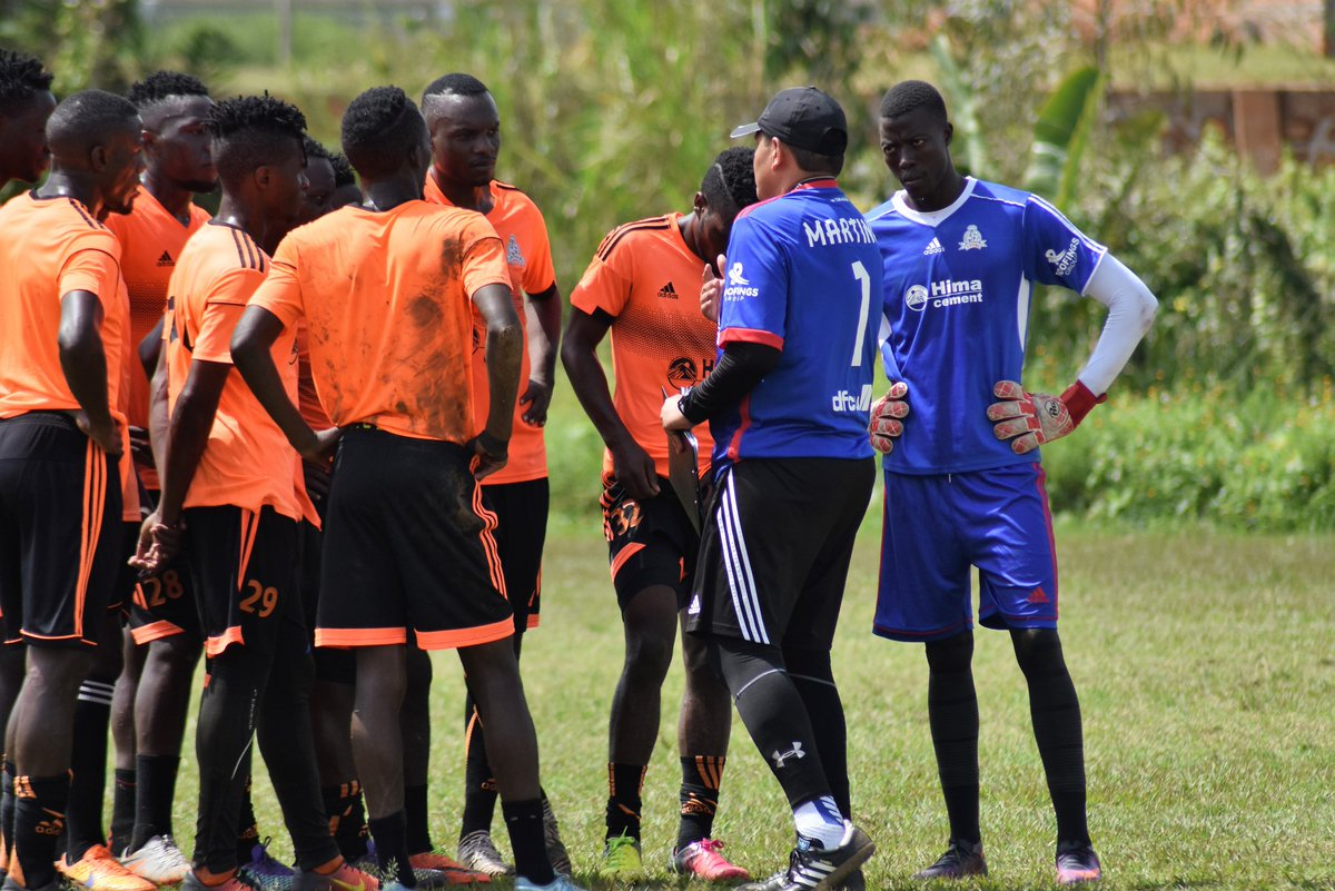Martinez engaging Lwanga and teammates during drills