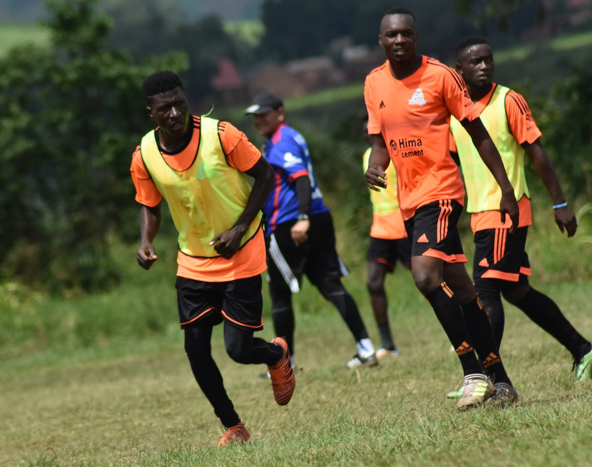 Lwanga right without bib is excited about the new coach