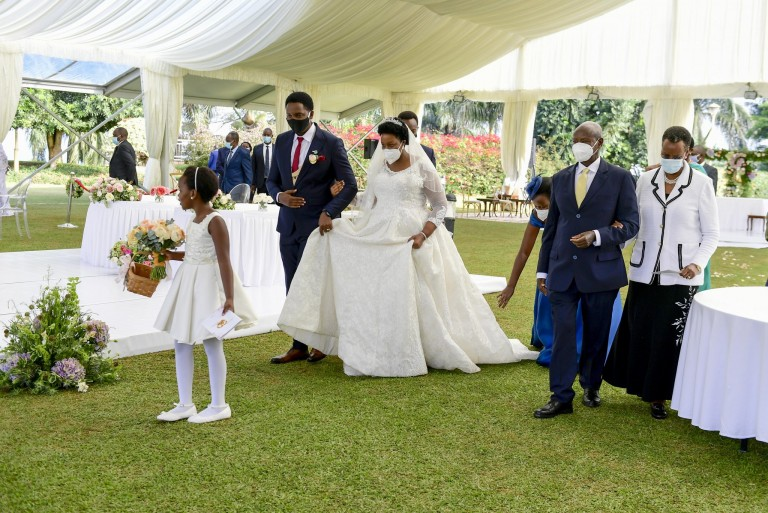 President Museveni accompanied by Janet attended scientific wedding of his cousin Akoragye in Entebbe on Saturday (PPU Picture)