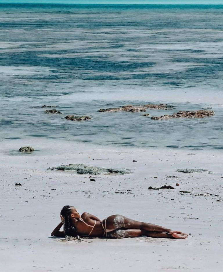 Sheilah eating money on baecation in Zanzibar fresh beach waters