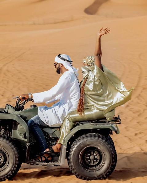 Rema and Hamza cruising on bike in Desert